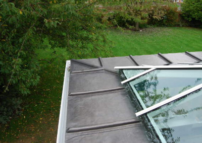 Dressed lead & timber mop rolls on an Orangery roof