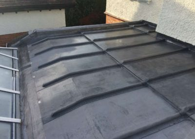 Lead flat roof with traditional timber mop rolls