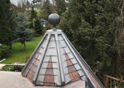 Leaded hips and finial on a octagonal roof structure
